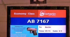 economy-class-with-handguns
